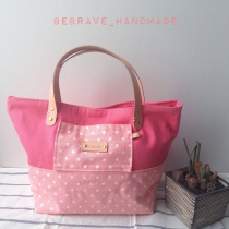 Pink polka dot mini tote at Blisby