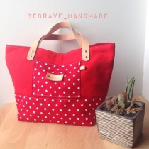 Red polka dot mini tote at Blisby
