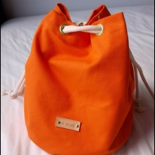 Spice Orange Canvas Bucket Bag at Blisby